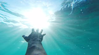 Savior-rescuer-salvation-hand-man-drowning-saved-by-lifeguard-underwater-sun-shining-rescue-new-hope-second-chance-concept-gopro-hd_4yspe9-fz__S0000