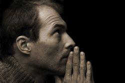 Man-praying-dark